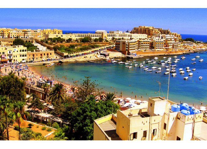 St Georges Bay in St Julian's malta, About Holiday Accommodation  Rentals in Malta & Gozo malta, Holiday Rentals Malta & Gozo malta